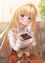 1girl blonde_hair blue_eyes blush breasts chocolate couch eating eyebrows_visible_through_hair food food_on_face fujishiro_kokoa highres indoors large_breasts long_hair long_sleeves original pleated_skirt red_skirt ribbed_sweater sitting skirt solo sweater turtleneck turtleneck_sweater valentine waist_bow white_sweater