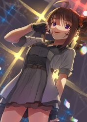 1girl, ahoge, arm behind back, belt, black belt, black gloves, black shorts, blouse, blurry, blurry background, brown hair, commentary, cowboy shot, diffraction spikes, dress shirt, drill hair, english commentary, fingerless gloves, gloves, grey blouse, grey skirt, headset, idolmaster, idolmaster million live!, kamille (vcx68), lady grisaille (idolmaster), looking at viewer, medium hair, miniskirt, open mouth, orange scrunchie, pleated skirt, purple eyes, scrunchie, shirt, short sleeves, shorts, side drill, side ponytail, skirt, smile, solo, stage lights, standing, yokoyama nao