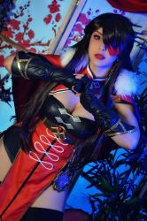 1girl, beidou (genshin impact), beidou (genshin impact) (cosplay), black bra, black gloves, black hair, black legwear, bra, breasts, capelet, china dress, chinese clothes, cleavage, cleavage cutout, clenched hand, clothing cutout, commentary, cosplay, cowboy shot, dress, dutch angle, electro (genshin impact), english commentary, eyepatch, eyeshadow, fists, fur trim, genshin impact, gloves, gold trim, hair ornament, hairpin, hand on hip, hand up, hands together, highres, indoors, lace, lace-trimmed dress, lace trim, lips, makeup, mascara, medium breasts, photo (medium), pirate, plant, pose, red dress, red eyepatch, red eyes, shermie cos, solo, tan, thighhighs, umbrella, underwear, vision (genshin impact)